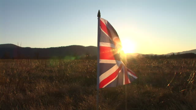 HD: British flag in the sunset