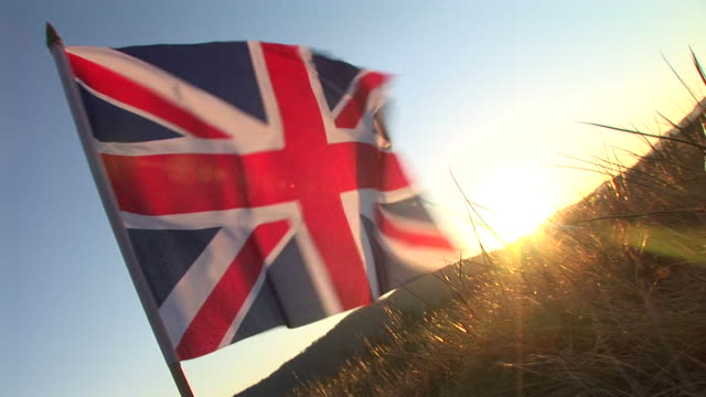 hd: british flag in the sunset - british flag stock videos & royalty-free footage