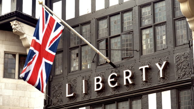 stockvideo's en b-roll-footage met british flag on liberty department store in london - brexit