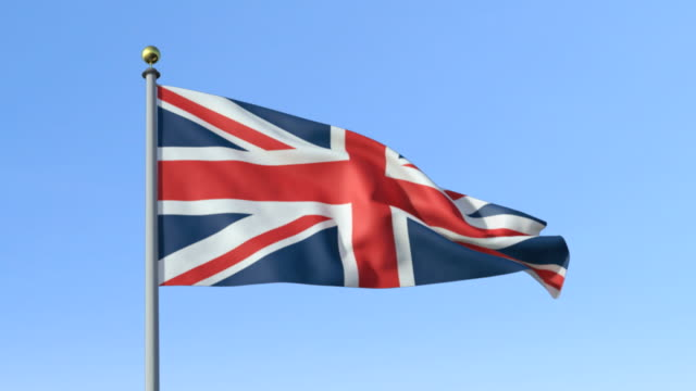ms, british flag waving against blue sky - bandiera del regno unito video stock e b–roll