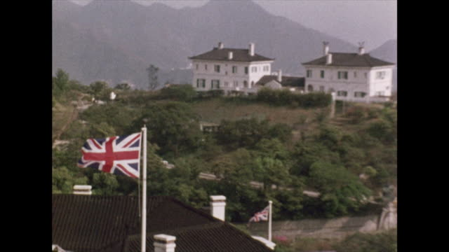 british flags fly at houses in hong kong, 1972 - britische kultur stock-videos und b-roll-filmmaterial