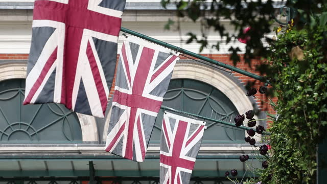 british flags hang outside a building at covent garden in london, u.k., on tuesday, may 11, 2021. u.k. prime minister boris johnson confirmed that... - flatten the curve stock videos & royalty-free footage