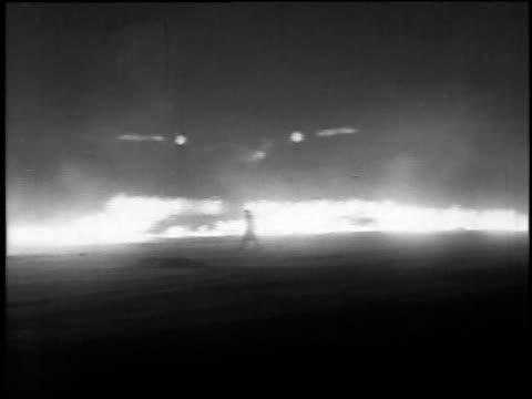 British fog dispersal plane flying over fire / United Kingdom