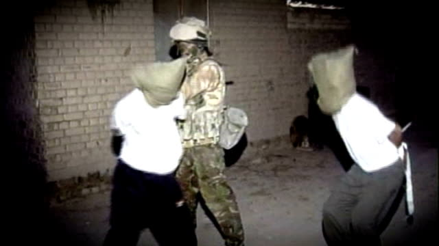 british forces interrogation methods broke international law says army's former chief legal officer lib t05040306 basra british soldier pulling on... - interrogation stock videos and b-roll footage