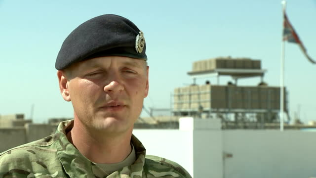 british forces reach another milestone in withdrawal from afghanistan; afghanistan: helmand: camp price: ext soldier wringing uniform as doing... - rubble stock-videos und b-roll-filmmaterial