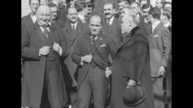 british foreign minister lord george curzon, italian prime minister benito mussolini, and french prime minister raymond poincare talking with group... - benito mussolini stock videos & royalty-free footage