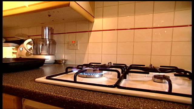 british gas announces 12 per cent rise in prices tx low angle side view of young woman using hob of gas cooker hob of gas cooker as gas ring lights... - hob stock videos & royalty-free footage