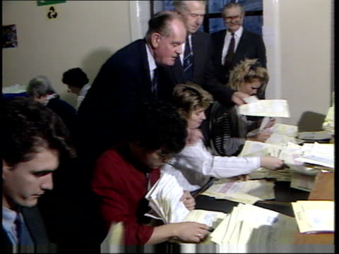 london people queuing to hand in applications applications put into boxes peter walker watching applications sorted thru intvw sir denis... - unemployment application stock videos & royalty-free footage