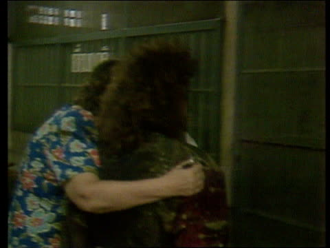 british girls released itn lib cms karyn smith being led along weeping in prison cms patricia cahill being put into cell in prison cms police... - loslassen aktivitäten und sport stock-videos und b-roll-filmmaterial