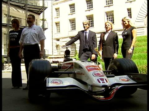 British Grand Prix Damon Hill and Rick Parfitt photocall and interviews ENGLAND London County Hall EXT Rick Parfitt and Damon Hill posing for...