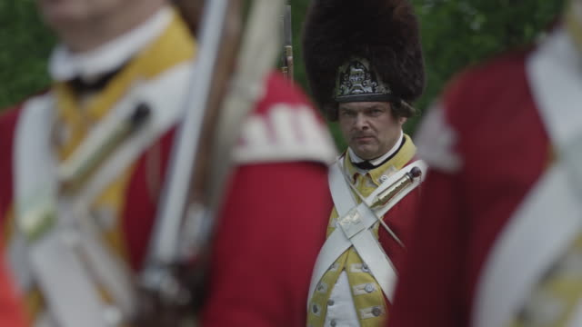 british grenadiers during the revolutionary war stand at attention. - coat stock videos & royalty-free footage