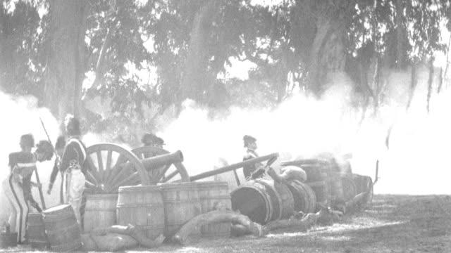 british gunners fire a salvo before grenadiers advance through smoke in a skirmish line. - gun stock videos & royalty-free footage