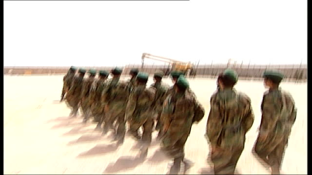 british gurkha regiment on training exercise / afghanistan army recruits training; side view afghan army commander as turns / afghan army recruits... - marschieren stock-videos und b-roll-filmmaterial