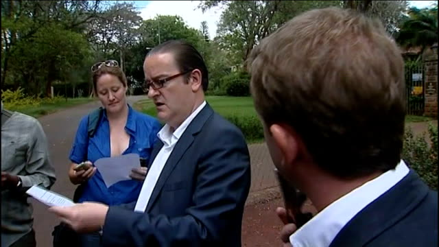 british high commission official handing out press release to journalists close shot of statement on paul and rachel chandler - press release stock videos and b-roll footage