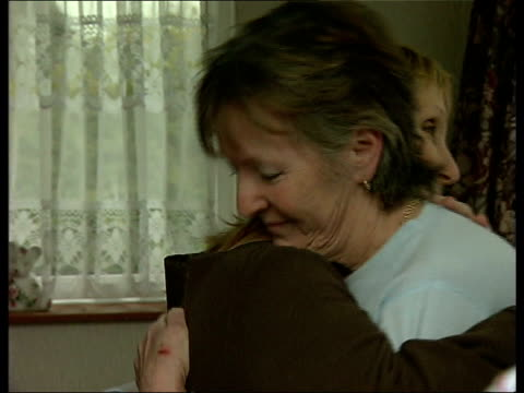northamptonshire wellingborough cms patricia teeley and relative hugging in doorway - northamptonshire stock videos and b-roll footage