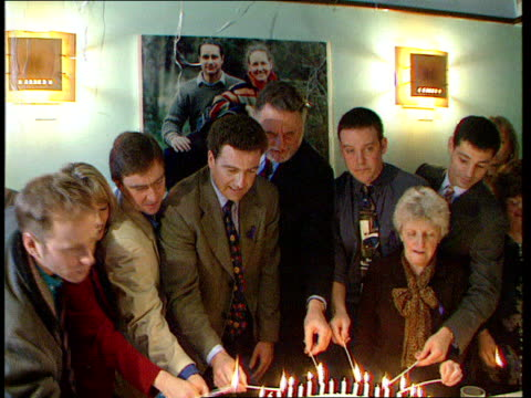stockvideo's en b-roll-footage met british hostages abroad **** see london groucho club int birthday cake for british hostage held in chechnya camilla carr with candles burning pull... - terry waite