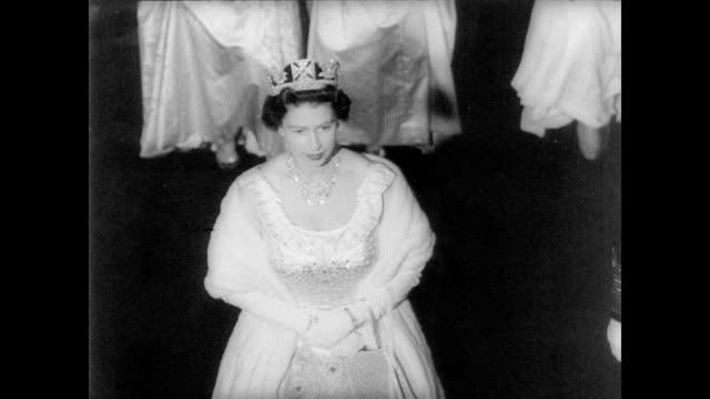 vídeos de stock, filmes e b-roll de british houses of parliament / queen elizabeth ii arriving by stage coach / prince philip escorts queen through halls of westminster / queen enters... - 1960