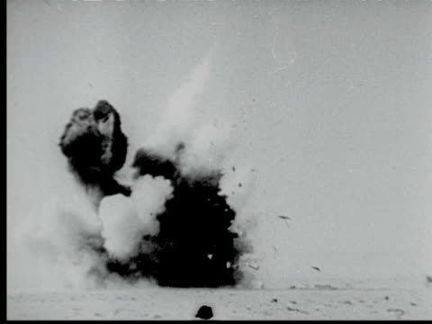 british howitzer gun fires shell explosion where shell hits men loading small cannon more explosions german tank on fire / tobruk egypt - flugabwehr stock-videos und b-roll-filmmaterial