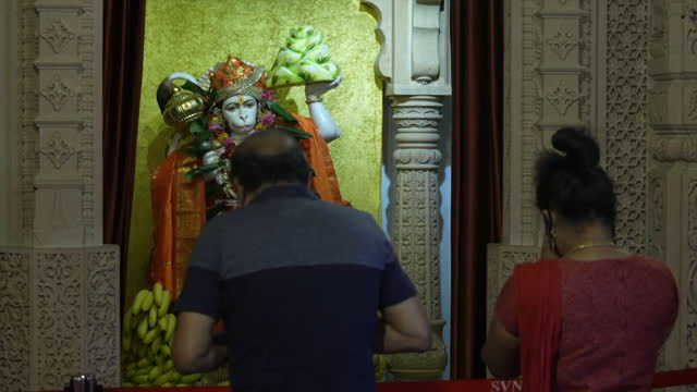 british indians praying and worshipping at shri vallabh nidhi temple, hindu temple in wembley, for their loved ones in india as the coronavirus... - place of worship stock videos & royalty-free footage