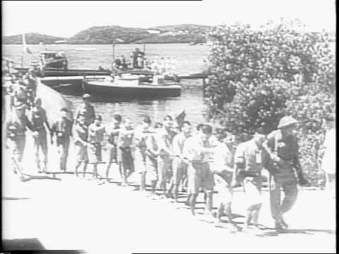 British invasion fleet approaches Rangoon / invasion fleet bearing British troops approached shore / landing craft approaches shore / animated map of...