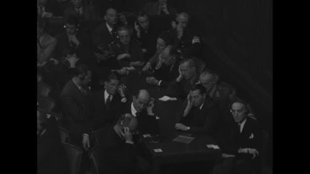 british judge norman birkett sitting at long table reading verdict russian judge iona nikitchenko sitting to his right sitting to his left british... - processi di norimberga video stock e b–roll