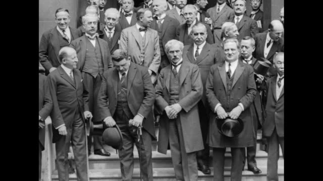 british labor minister ramsay macdonald and french premier edouard herriot stand outside with numerous other attendees of the london reparations... - botschafter stock-videos und b-roll-filmmaterial