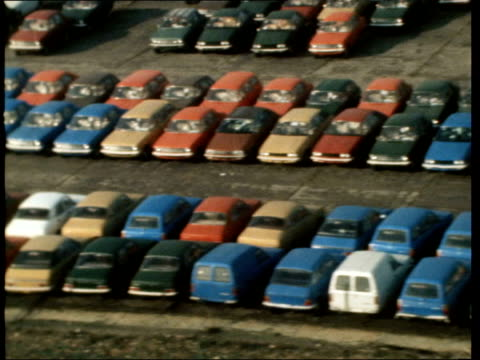 british leyland launch new sales campaign; england: oxfordshire: cowley: air view leyland factory: air view cars in lines - shadow of 'copter seen:... - the cars stock videos & royalty-free footage