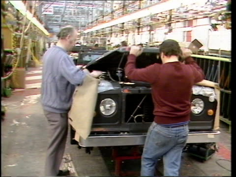 british leyland sell off itn lib land rover works bv one man opens bonnet of land rover on prod line as second man stands beside man holds open... - land rover stock videos and b-roll footage