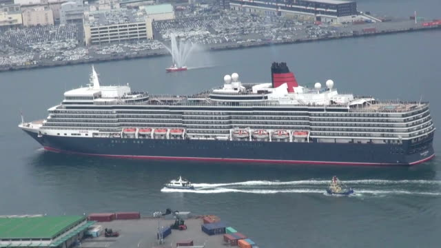 british luxury cruiser queen elizabeth entered port of kobe, western japan wednesday march 18, on an unscheduled stop due to journey delay caused by... - pacific war stock-videos und b-roll-filmmaterial
