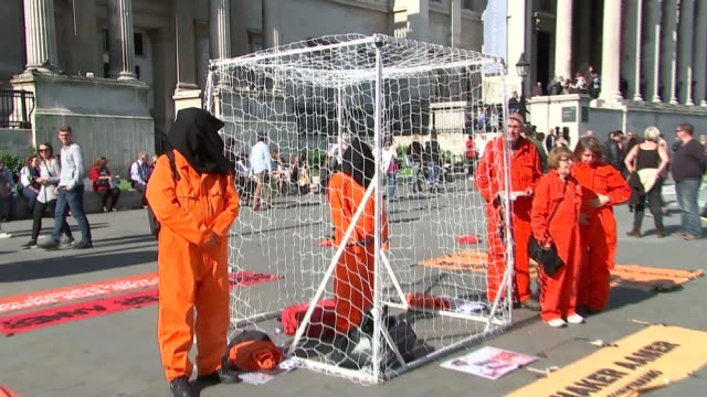british man shaker aamer to be released from guantanamo bay r16051510 trafalgar square large inflatable figure with the face of shaker aamer pull out... - shaker aamer stock videos & royalty-free footage