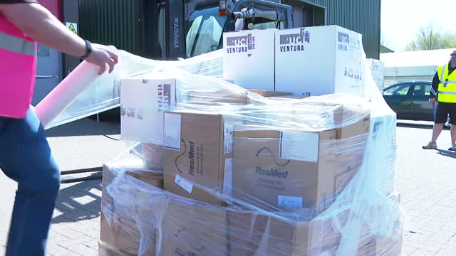 british medical aid, including ventilators and oxygen concentrator devices, packaged up and loaded onto lorry in uk to be sent to india to help as... - commercial land vehicle stock videos & royalty-free footage