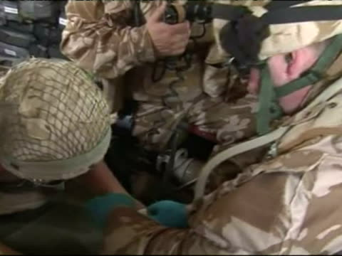 british medical emergency response team treat a wounded soldier on board a helicopter - stretcher stock videos and b-roll footage