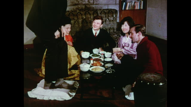 MONTAGE 1966 British men and Korean women share a meal in Korea