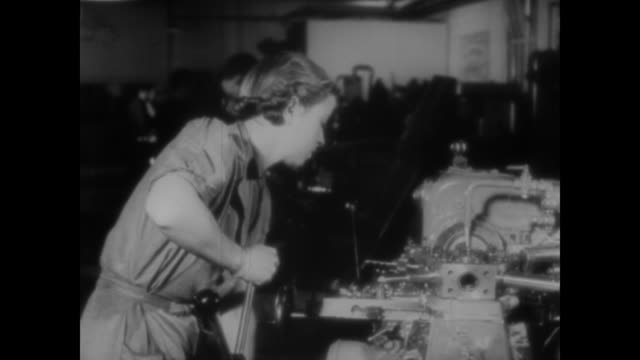 wwii british men and women work all the hours they can to run the munition factories during the war - munition stock-videos und b-roll-filmmaterial