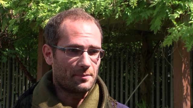 british men talk of fighting alongside kurdish rebels and their fears about turkish involvement; england: london: gifford interview sot - talks of... - porous stock videos & royalty-free footage