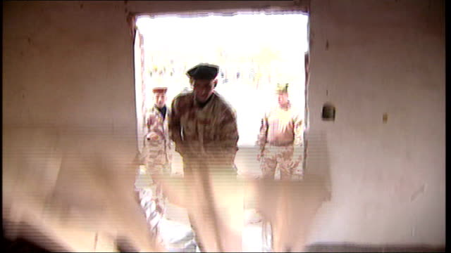 stockvideo's en b-roll-footage met british military hand control of basra over to local security forces; british base nr basra: ext sequence iraqi army recruits taking part in training... - military recruit