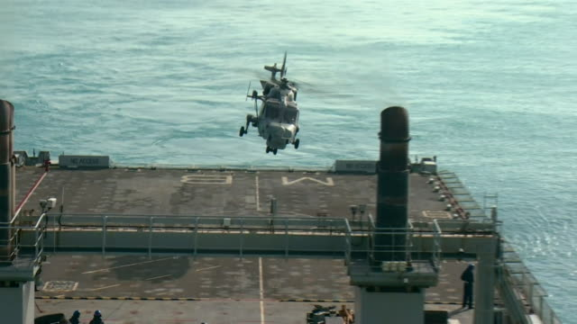 a british military helicopter taking off from rfa mounts bay as it searches for hurricane dorian survivors in the bahamas - destruction stock videos & royalty-free footage