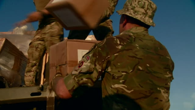 british military personnel delivering aid to people affected by hurricane dorian on the abaco islands in the bahamas - emergency shelter stock videos & royalty-free footage