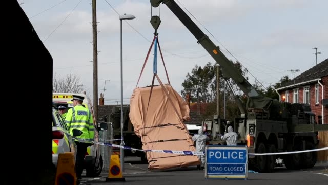 british military personnel dressed in protective overalls seize a vehicle on a residential street in gillingham kent allegedly linked to the march 4... - military attack stock videos and b-roll footage
