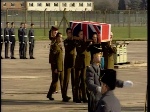 british military servicemen carry coffin containing body of one hundreth british soldier killed in iraq draped in union jack and place into hearse 31... - hearse stock videos & royalty-free footage