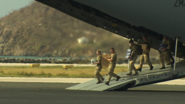 british military soldiers arriving in the british virgin islands to provide aid to survivors of hurricane irma - british military stock videos and b-roll footage