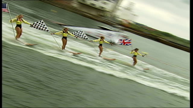 british motor show held at excel centre in london; ext line of skiers along river thames as part of water show back view skiers along as they fall... - chicago air and water show stock videos & royalty-free footage