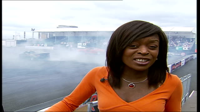 British Motor Show held at Excel Centre in London Reporter to camera PAN to stock cars twisting around DISSOLVE
