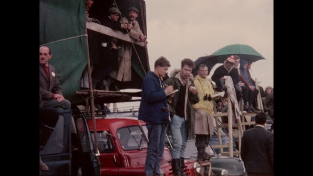 british motor sport fans watching the international trophy meeting at silverstone circuit in northamptonshire, england in 2nd may 1964. - northamptonshire stock videos & royalty-free footage