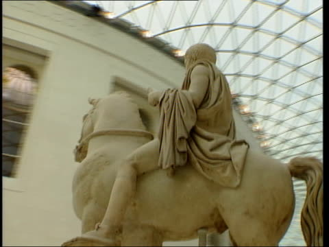british museum great court refurbishment; ext chestnut seller outside museum track forward towards museum entrance int track forward thru british... - british museum stock videos & royalty-free footage