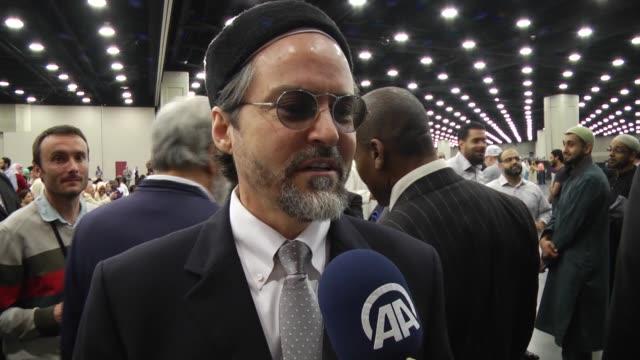 British musician Yusuf Islam and Shaykh Hamza Yusuf President and cofounder of Zaytuna College talk to journalists as they arrive at Freedom Hall to...