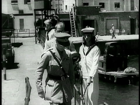 vídeos de stock, filmes e b-roll de british officer saluting walking down dock / israel / documentary - 1948