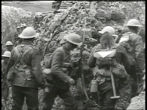 british officers standing at bend in trench watching soldiers walking by in single file note brief glitch in image soldiers in trench begin to run - trench stock videos & royalty-free footage