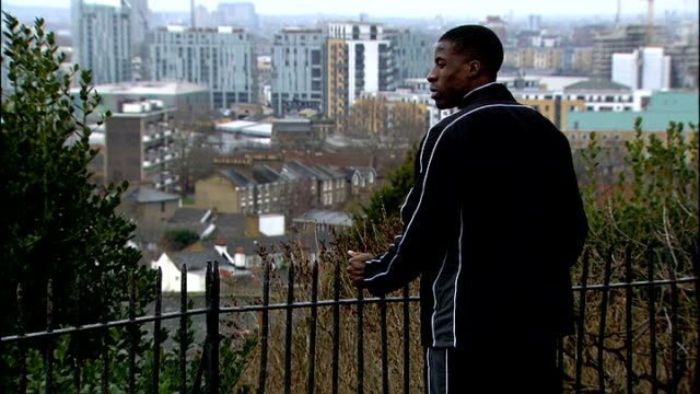british olympic association could lose in court battle to ban drugs cheats t08031204 ext dwain chambers at railings overlooking london dwain chambers... - 見渡す点の映像素材/bロール