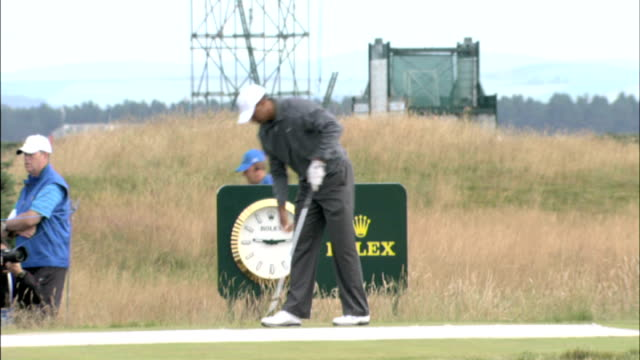 tiger wood speaks to press scotland st andrews ext tiger woods teeing off during practice round woods along on golf course with caddy - teeing off stock videos & royalty-free footage